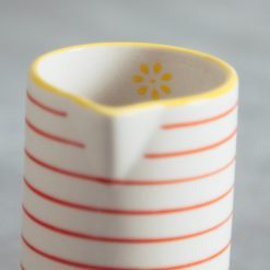 susie q orange stripe pitcher creamer relish decor detail